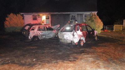 Gutted cars show the damage caused by the fire