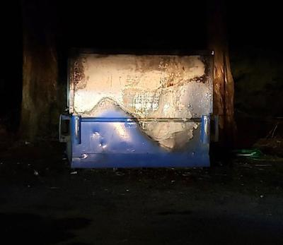 Dumpster damaged by fire