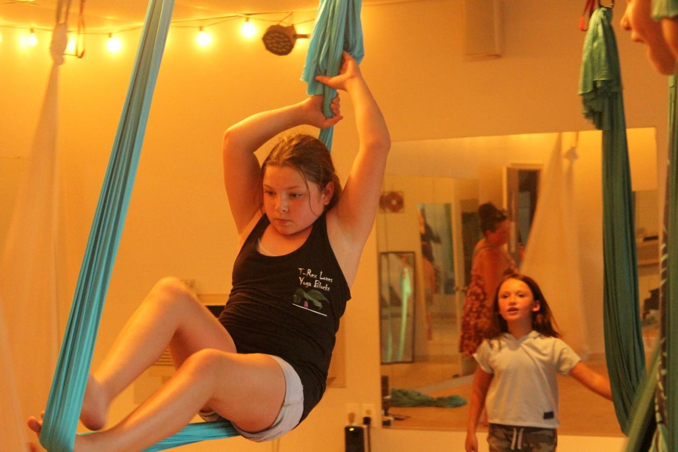 Young yoga fans take aerial equipment for a run