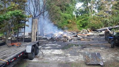Bayly Road garage burns a third time