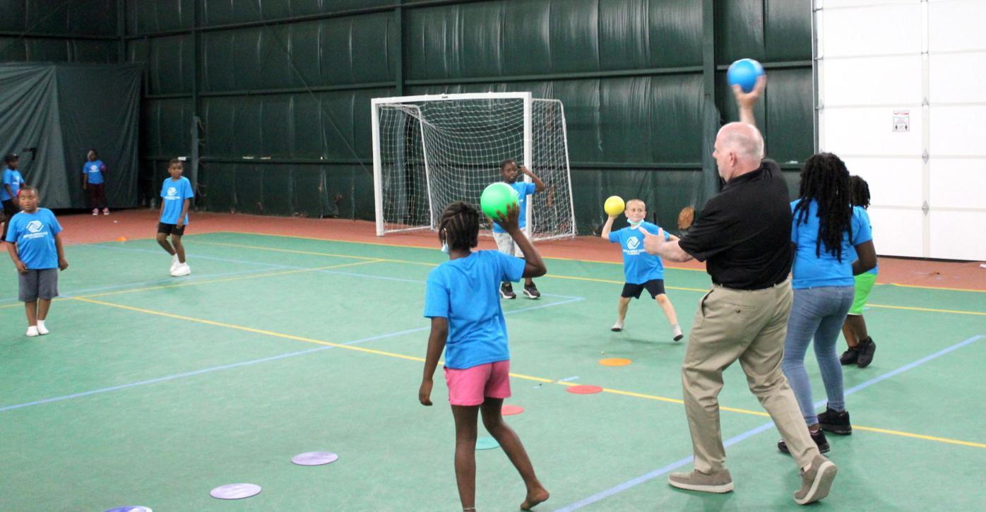 Hogan visits Cambridge Hogan throws