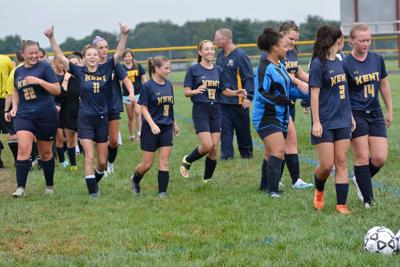 Sure-footed Trojans score 10-0 victory in rainy soccer opener