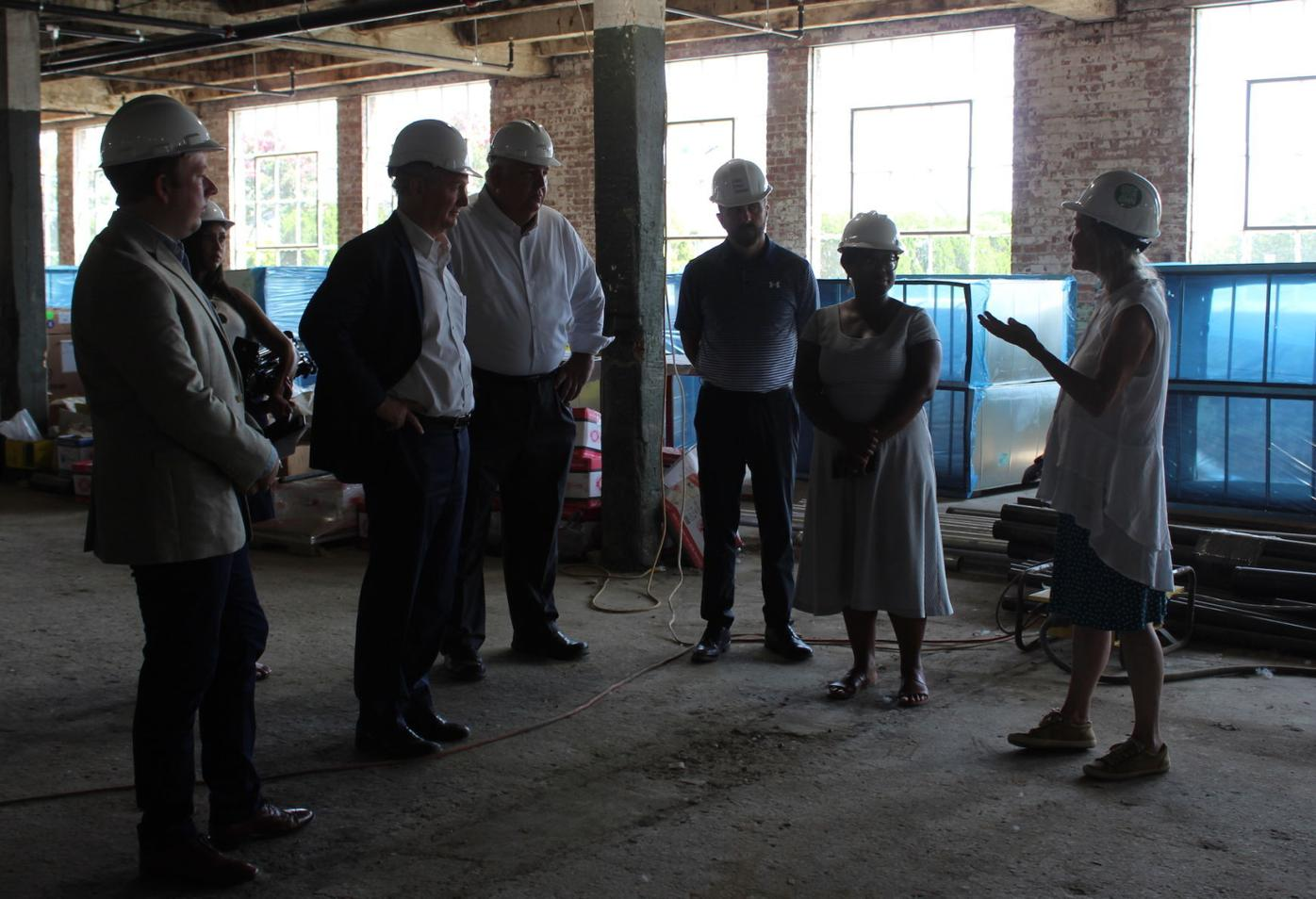 Senator Chris Van Hollen and others tour the Packing House
