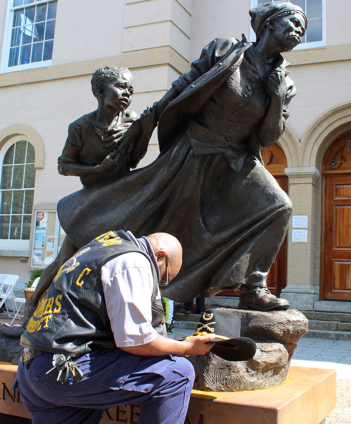 Day of Resilience Tubman statue Buffalo Soldier kneels