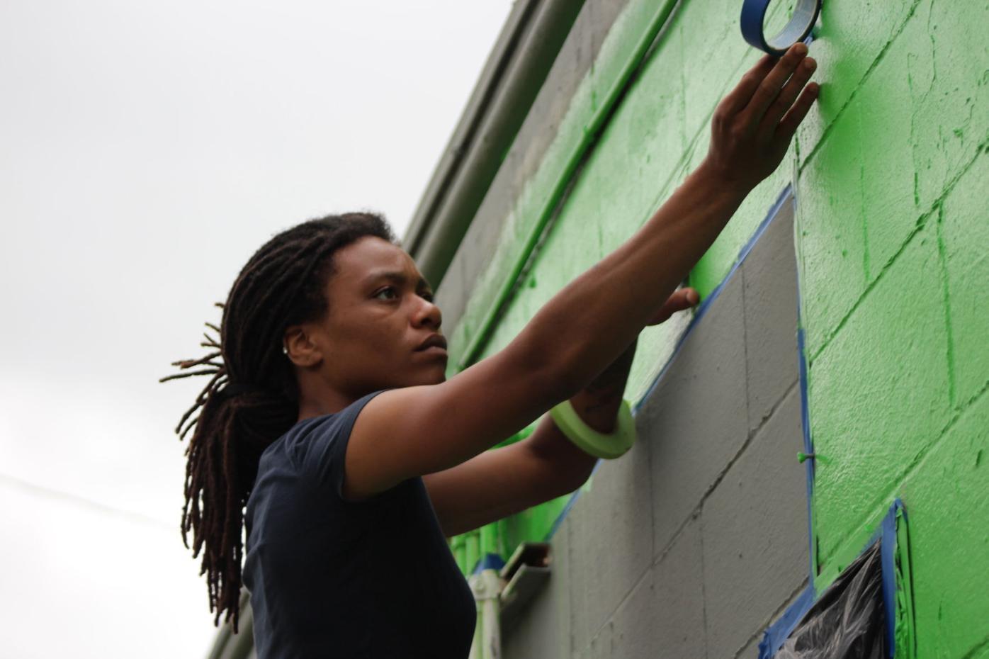 Artist Bobbie Jo-Elle Ennels tapes out mural