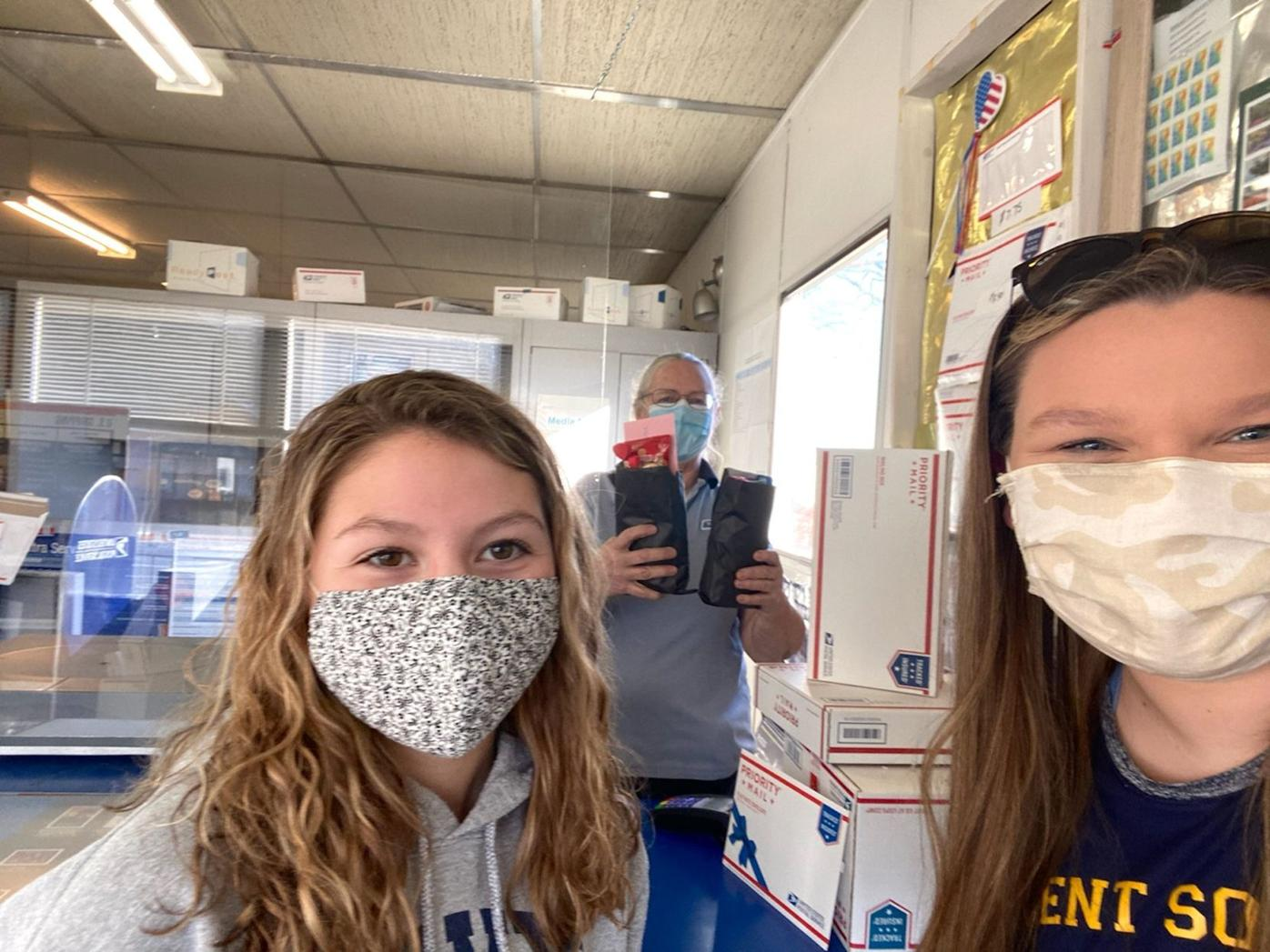 Youth group delivers care packages to postal workers