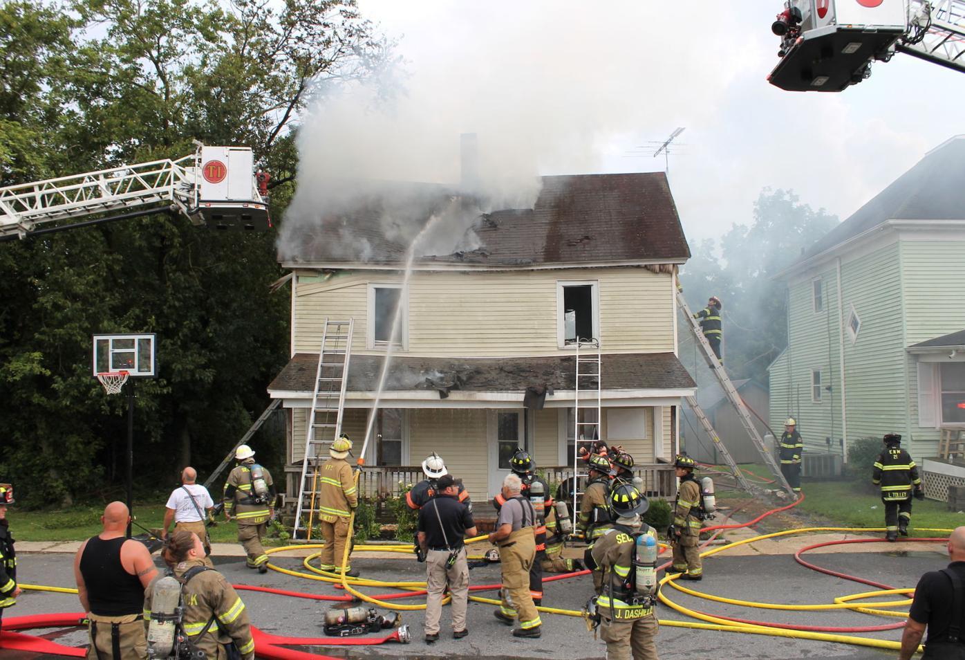Fire fighters battle a house fire in Hurlock