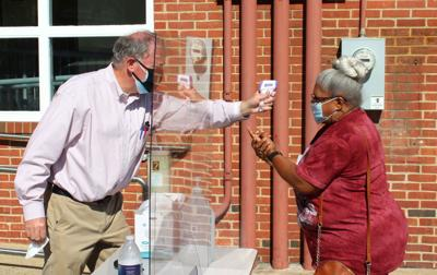 Election Supervisor completes screening for Cambridge voter