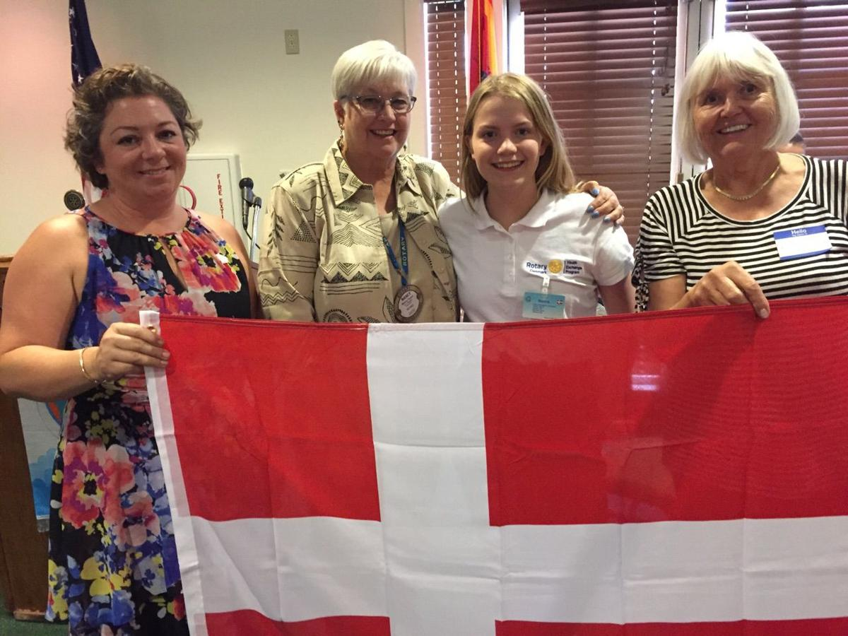 Rotarian Karina Rice-Roberts and first host Mom; President Nancy Fusco; Danish Exchange Student Nanna Johansen; and, second host Mom Berit Wallaker proudly display the Danish flag Nanna gifted her host Rotary Club.