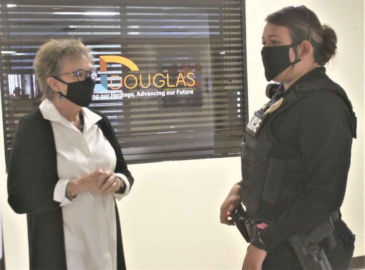 Face coverings now required in Douglas