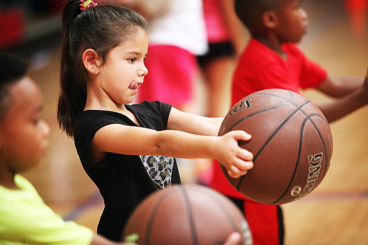 Photo gallery: Children's basketball camp with former NBA player, coach