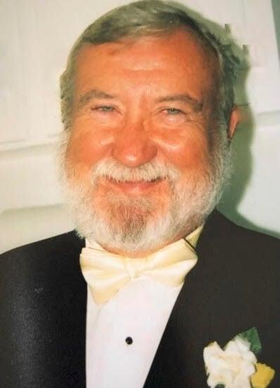 James A. Demuth, 77