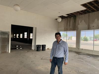 Mark Phillips inside future home of second tasting room for Golden Rule Vineyards