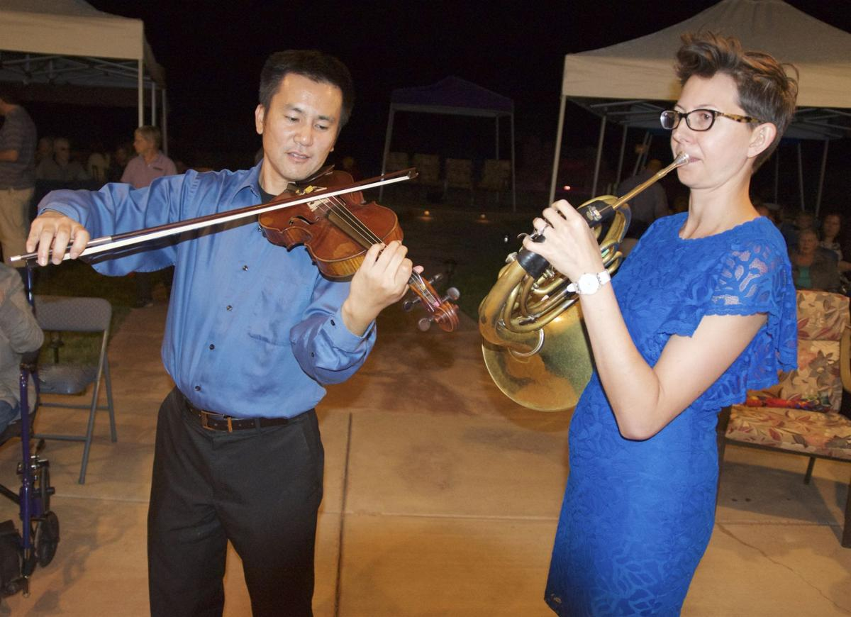 """Sierra Vista Symphony Orchestra Artistic Director Toru Tagawa and Tucson Symphony Johanna Lundy perform an outdoor concert Saturday evening at the home of Cal and Mary Downing. The cancer, """"Music at Twilight,"""" is a kickoff fundraiser for the Sierra Vista Symphony's 23rd concert season."""