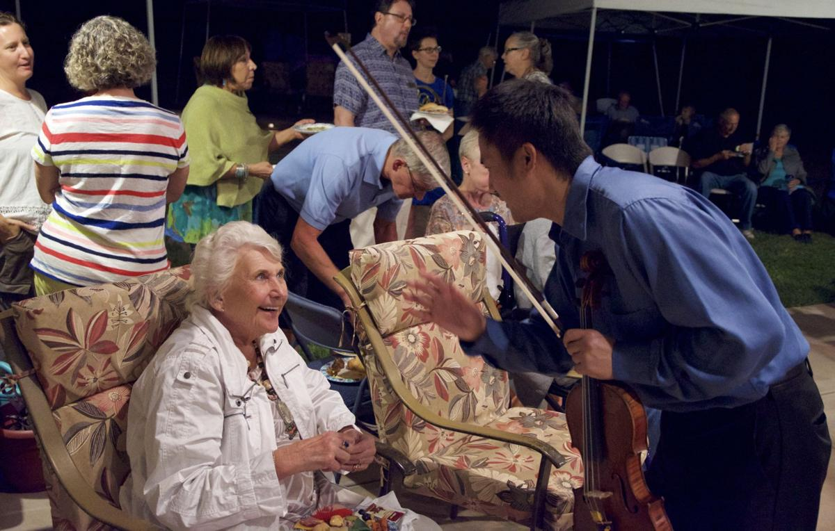 Dr. Barbara Brown and Sierra Vista Symphony Orchestra Conductor Toru Tagawa chat during an intermission at Music at Twilight.