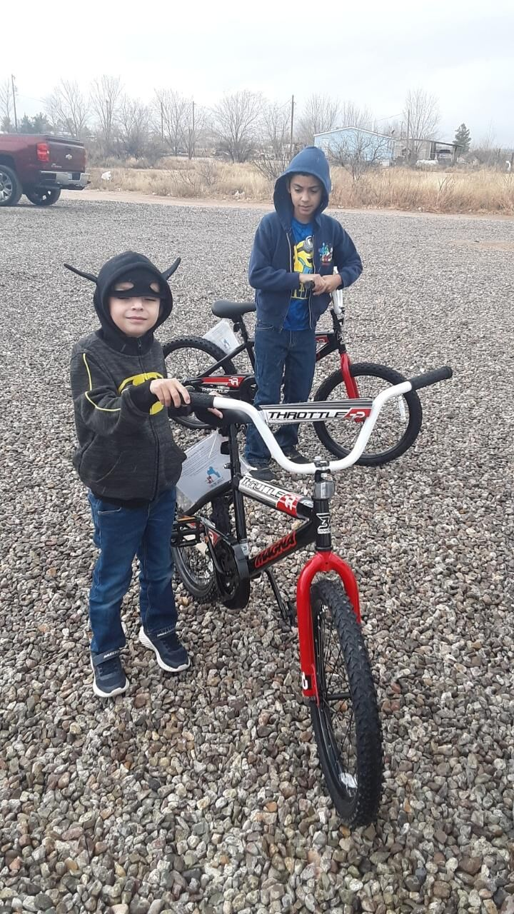 Two happy boys pose with their new bikes donated by SEACAP of Northern Cochise County
