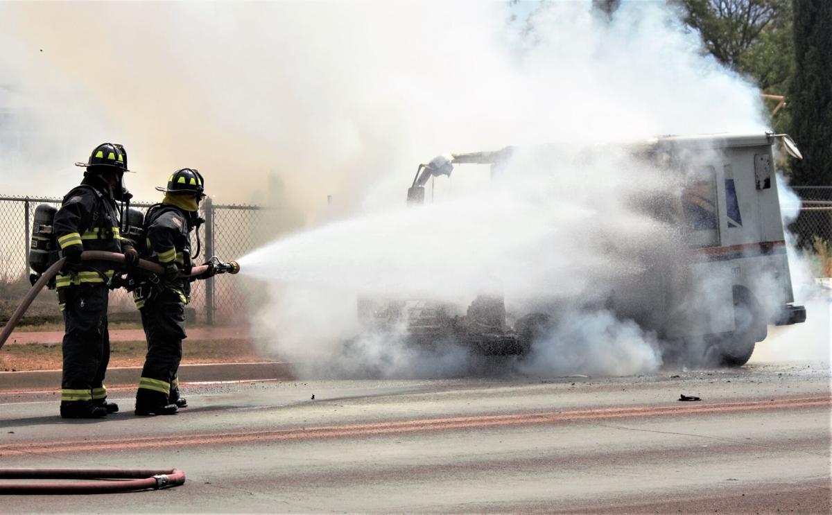 Fire engulfs postal vehicle