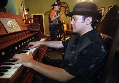 Musician Ben Caron accompanies Magic Kenny Bang Bang during a family-friendly Halloween show in the Bisbee Séance Room last October. Caron is playing a vintage bellows organ.