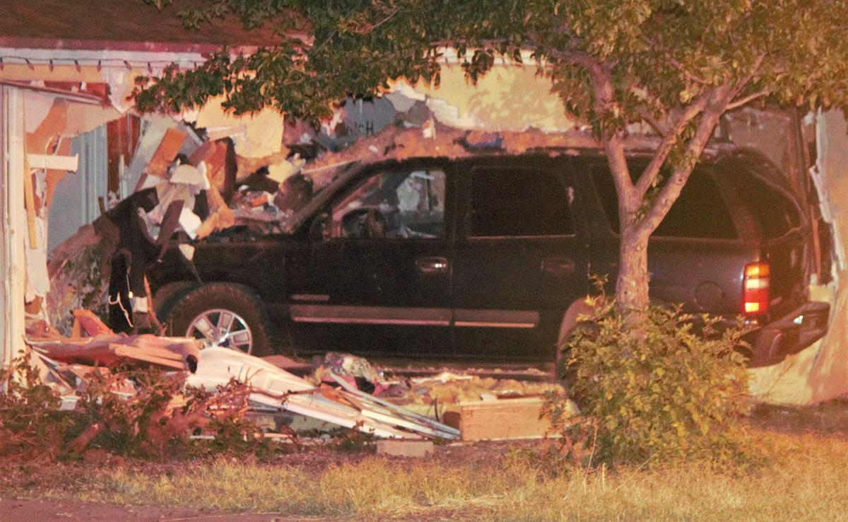 Vehicle crashes into residence in domestic violence related incident