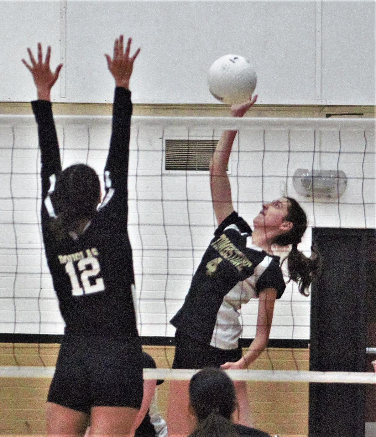Jazmin Gil-Uriaz powers a kill past Deyanira Vicotor of Douglas.jpg