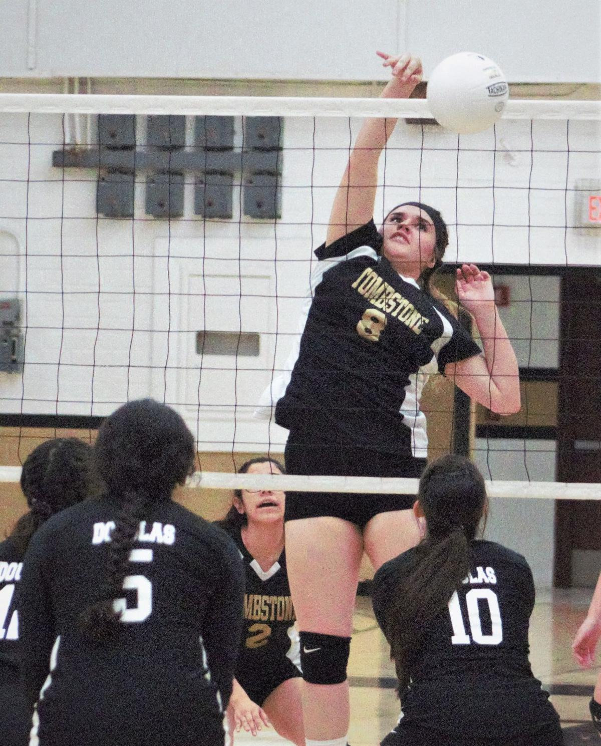 Ilissa Wiley knocks down the final point of the first set giving Tombstone a 25-16 win..jpg