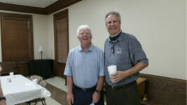 Golf course guru Pat O'Brien, left, with Forsyth barber Lee Smith, shared his wisdom with the Forsyth-Monroe County Kiwanis Club on Sept. 29.