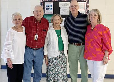 Dr. Richard Bazemore, second from left, is pictured with family members, from left, wife Janne, Richard, mother Dot Bazemore, brother Bill Bazemore and Bill's wife Julie Bazemore, at a reception honoring his retirement at T.G. Scott Elementary.