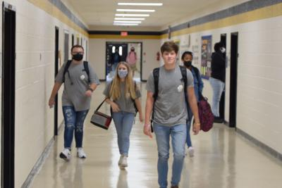 Students wear masks in the hallway of Mary Persons High School.