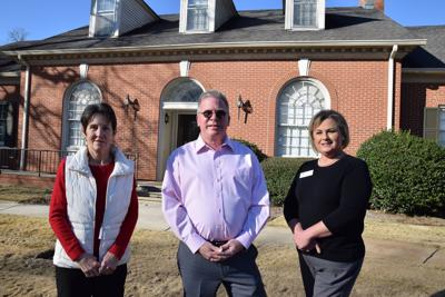 From left, Connie Ham of ERA Middle Georgia Realty, Jim Bond of Forsyth Cable and Rebecca Stone of the chamber of commerce.