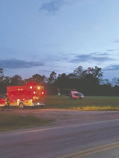 A Lifeflight helicopter picks up Bobby Strickland, the driver in a wreck that killed his Forsyth passenger. (Photo/April Garner)