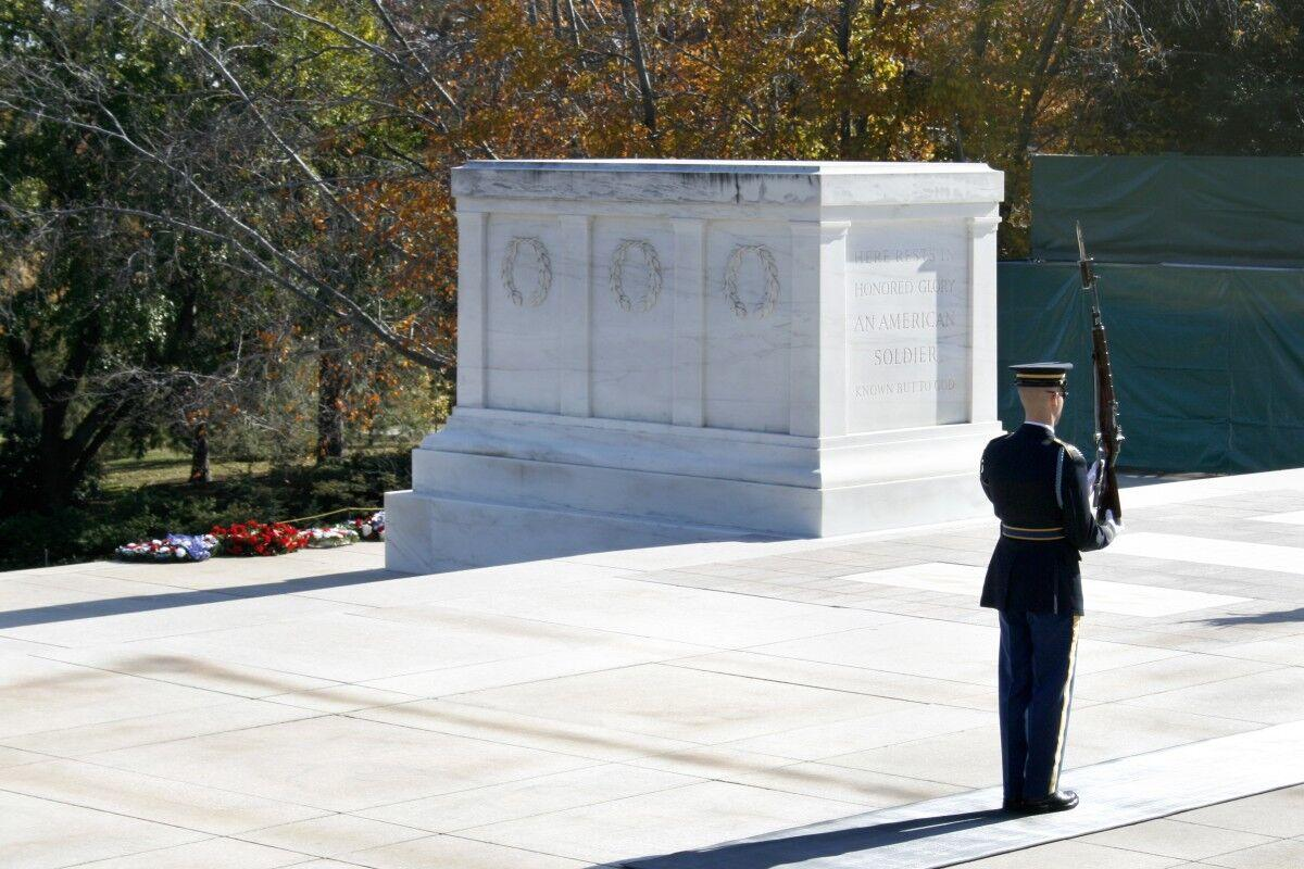 A guard steps off at the Tomb of the Unknown Soldier.