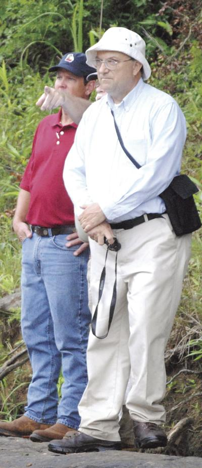 Bibb County engineer Paul Hoinowski, right, shown at the disputed county line on the Ocmulgee River with then-secretary of state, now governor, Brian Kemp.