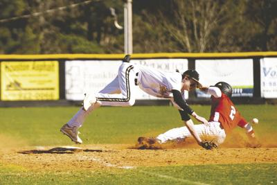 Jaden Bankston leaps for the throw at third base in MP's 13-12 win over Morgan County on Saturday. Bankston had a walk-off single in the bottom of the seventh to win the game. (Photo/John Belknap/www.johnbphotography.net)