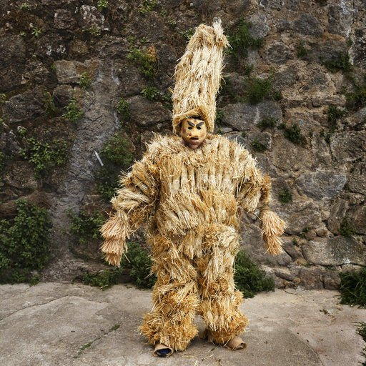 AP PHOTOS: Costumed characters converge on Spanish town