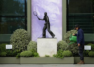 11 o'clock and all's silent on Wimbledon's would-be Day 1