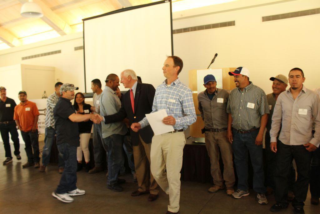 Mike Thompson congratulates farmworkers