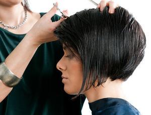 woman getting a hair cut.jpg