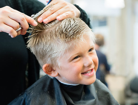 young boy getting a haircut