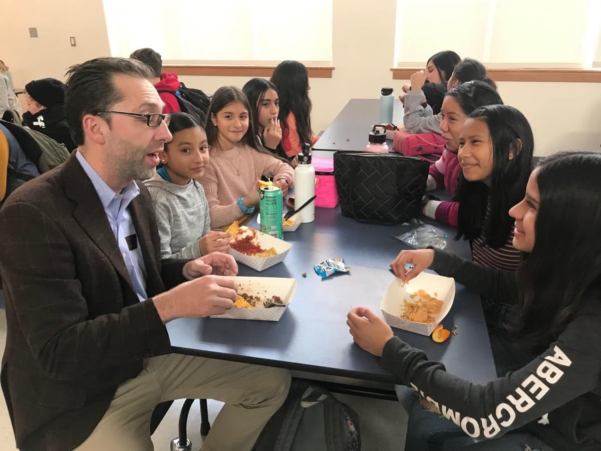 RMS principal and students at lunch