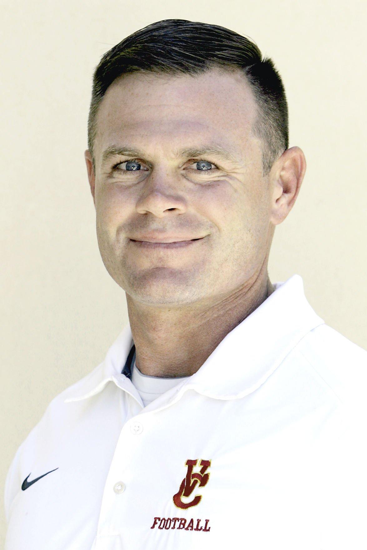 Vintage High School varsity football coach Kyle Hofmann
