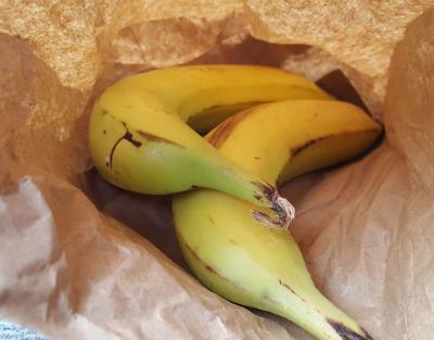 Bananas in brown paper bag