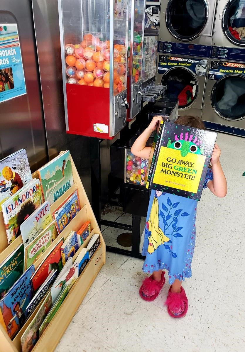 A young reader and books at a Napa library laundry.