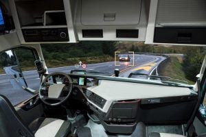 Self driving truck with head up display on a road. Photo illustration by Scharfsinn86.