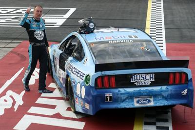 Kevin Harvick, driver of the #4 Busch Light YOURFACEHERE Ford, celebrates winning the NASCAR Cup Series The Real Heroes 400 at Darlington Raceway on Sunday, May 17, 2020 in Darlington, S.C. NASCAR resumes the season after the nationwide lockdown due to the ongoing coronavirus pandemic.