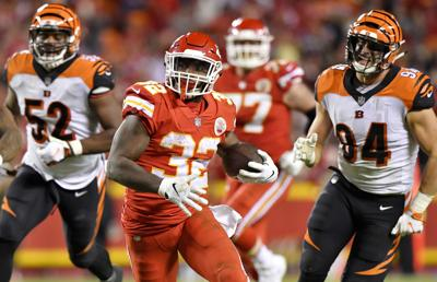 Kansas City running back Spencer Ware races down the field past Cincinnati Bengals Preston Brown (52) and Sam Hubbard during the second half on Sunday, Oct. 21, 2018 at Arrowhead Stadium in Kansas City, Mo.