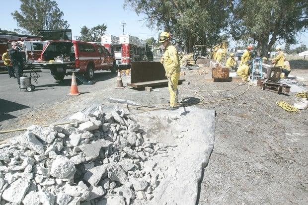 Firefighters Prepare Steel Beams for 9/11 Memorial