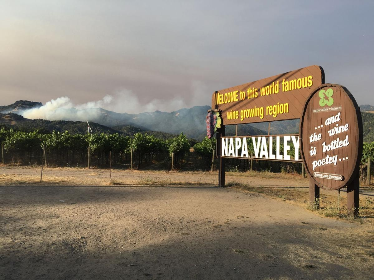 Fire burns in sight of Napa Valley welcome sign
