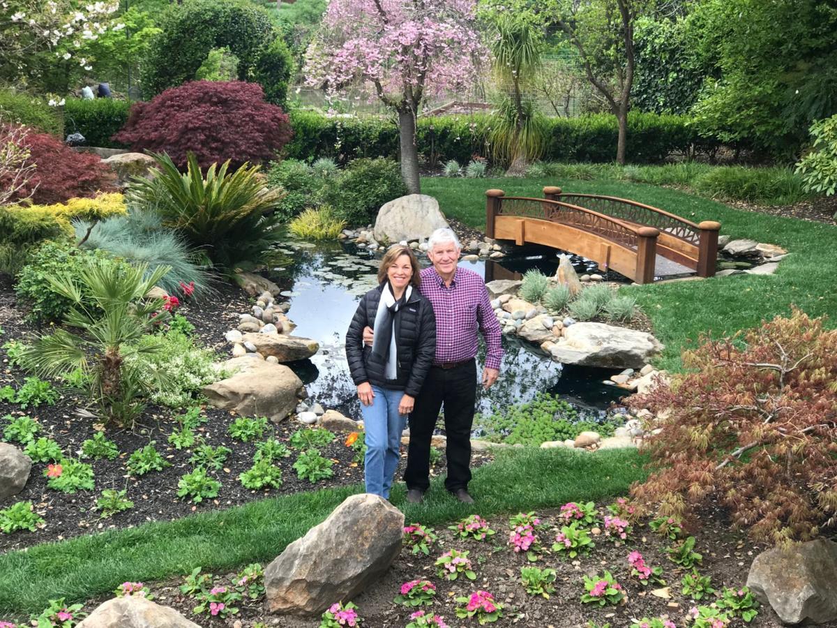 Maureen Dolan and Jon Huttinger as seen in the elaborate backyard garden of 1105 Juarez St.