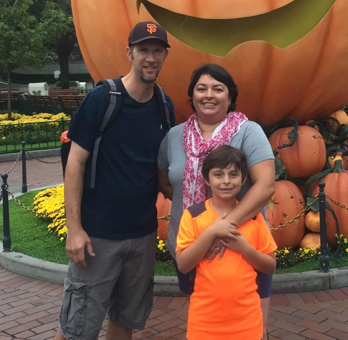 Karina Servente with husband and son