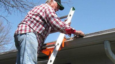 When raising your roof ladder up to the apex of the roof, be sure to do so at least three feet away from a chimney or other obstacle so that you can easily flip the ladder over when needed.
